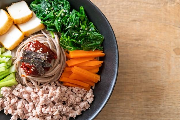 Korean spicy cold noodles called bibim makguksu