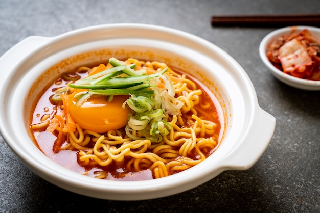 Korean spicy instant noodles with egg, vegetables and kimchi