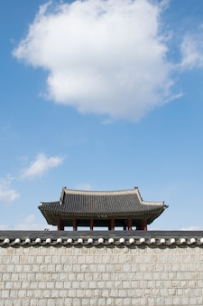 Korean traditional house with cumulus clouds