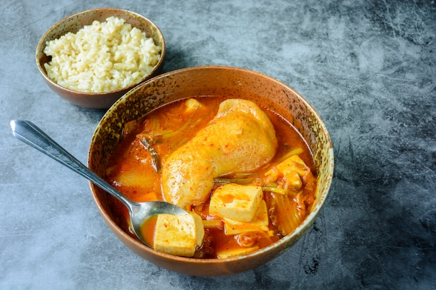 Korean traditional kimchi soup with chicken and soft tofu