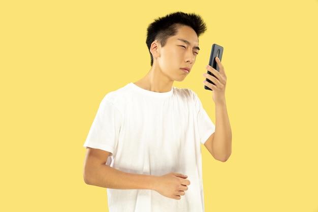 Korean young man's half-length portrait on yellow wall