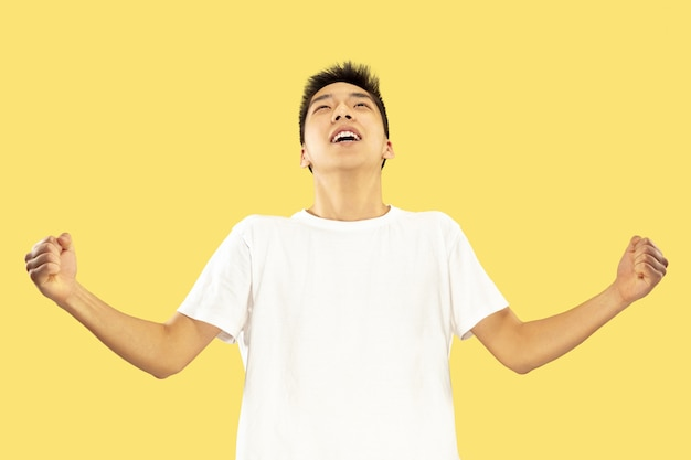 Korean young man's half-length portrait on yellow wall