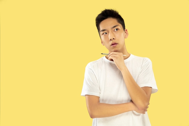 Korean young man's half-length portrait on yellow