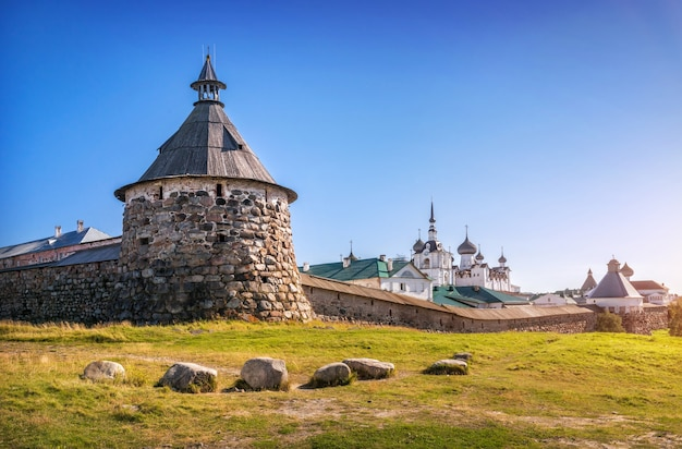 Korozhnaya tower and temples of the solovetsky monastery and stones on green grass