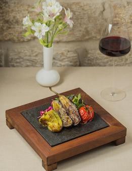 Kozleme, local food served on steak board.