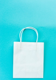 Kraft bag on turquoise background. eco packaging for shopping.