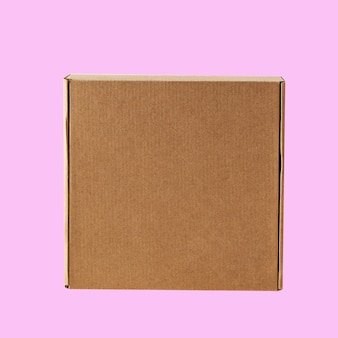 Kraft cardboard square closed box top view on a pink background