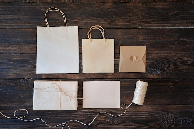 Kraft carton gift box and handle package on wood