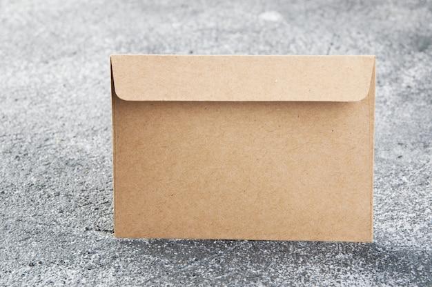 Kraft envelope on gray textured background