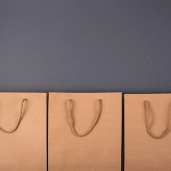 Kraft paper bag on bright dark surface.