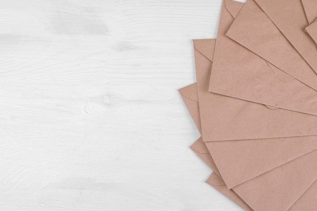 Kraft paper envelopes with space for inscriptions. view from above. mail or delivery concept