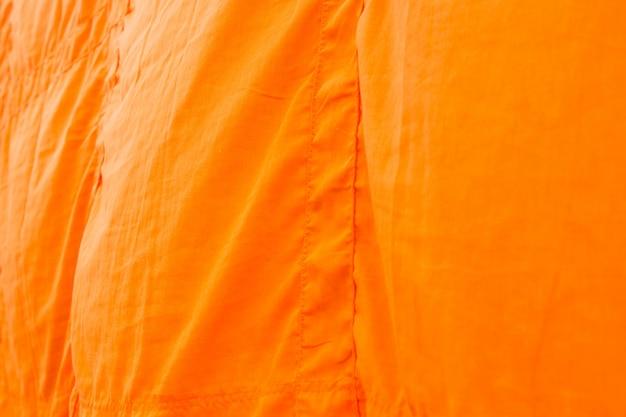 仏教の僧ksと修道女のアジアの仏教徒によるカサヤの衣服またはローブの衣服