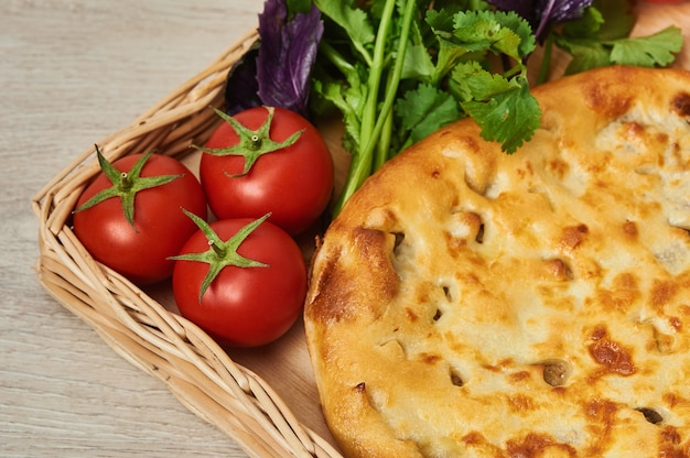 Kubdari is a traditional georgian dish of meat-filled fragrant bread which is particularly a national dish of the svans on a wooden table