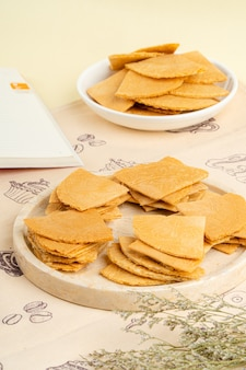 Kue semprong is an indonesian traditional wafer snack made by clasping egg batter using an iron mold