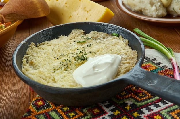 Kugelis , potato pudding, lithuanian  cuisine, baltic traditional assorted dishes, top view.