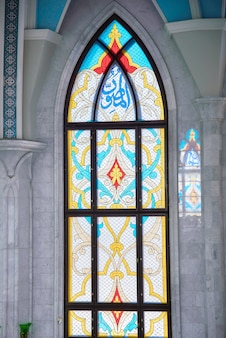 Kul sharif mosque, interior of the main hall with a stained glass window