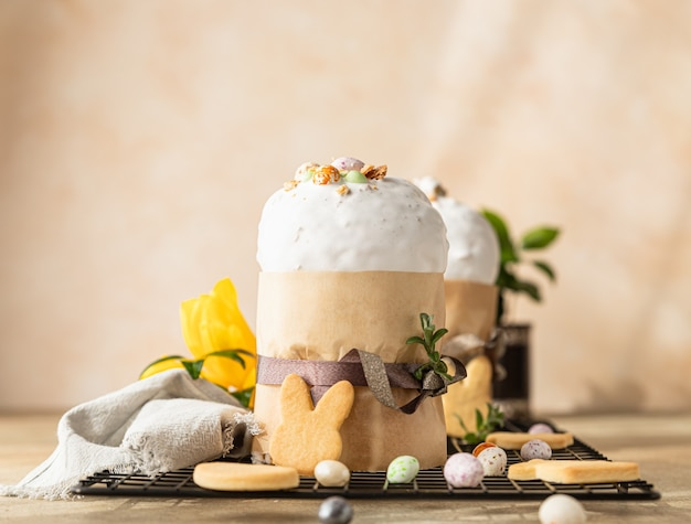 Kulich traditional orthodox easter sweet bread decorated with meringue icing and candy shaped eggs
