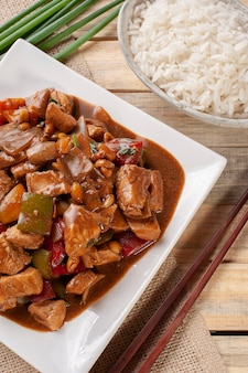Kung pao chicken. chinese traditional food. chess chicken. top view