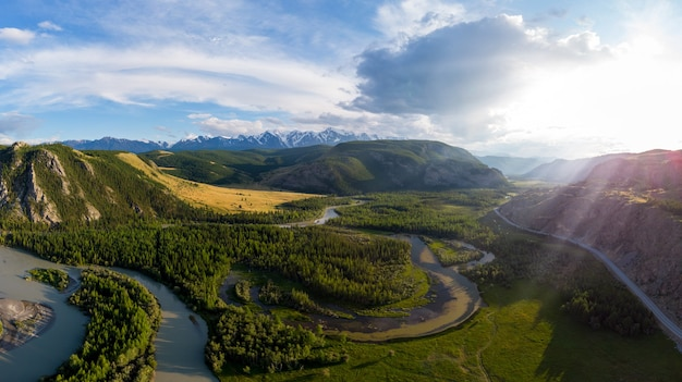 Kurai steppe and chuya river on northchui ridge mountains background altai mountains russia aerial d...