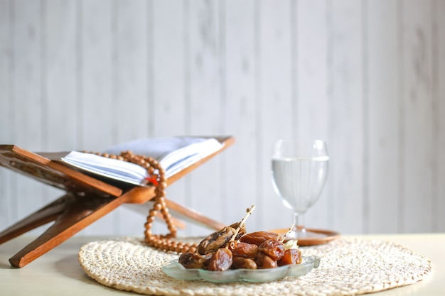 Kurma or dates fruit with glass of water