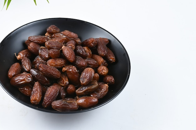 Kurma or sweet dried palm fruit isolated on white background