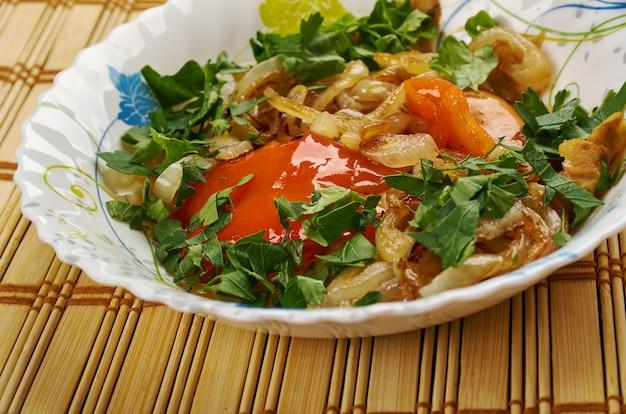 Kurutob - tajik dish with pita bread and vegetables