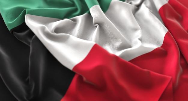 Kuwait flag ruffled beautifully waving macro close-up shot