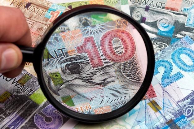 Kuwaiti dinar in a magnifying glass