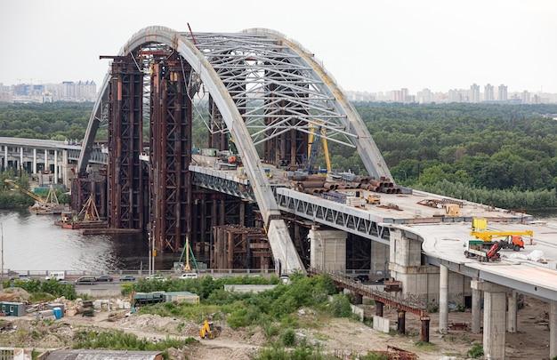 Kyiv, ukraine - jun 04, 2019: construction of the podolsky bridge in kyiv. construction of traffic artery. construction of the bridge across the river