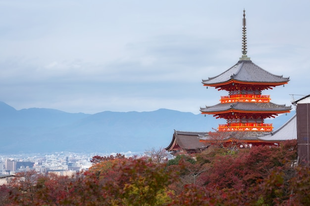 Kyoto city and red pagoda of kiyomizu-dera temple in autumn