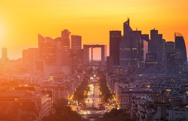 La defense district business in paris at sunset, view from arc de triomphe