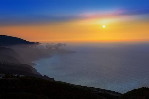 La palma muntains sunset with orange sun