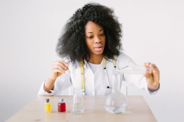 Lab assistant testing water quality. portrait of a young beautiful  girl researcher chemistry student carrying out research in a chemistry lab