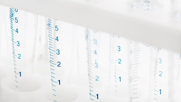 Lab tubes with measurements close-up