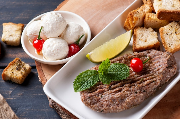 Labaneh balls and kibbeh.  variety of snacks from arab cuisine