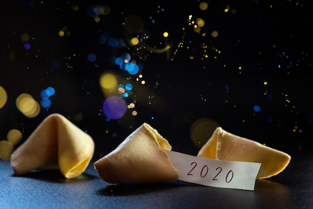 Label congratulating the new year 2020 on a lucky cookie, ideal for greeting cards.