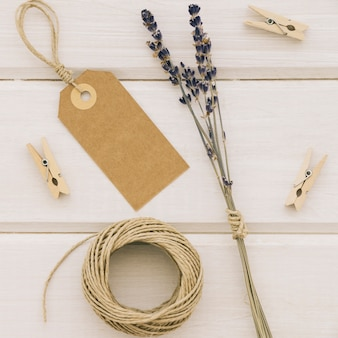 Label, flowers, clothespins and cord