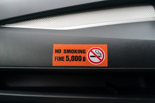 Label no smoking in the car, no smoking in the public vehicle and taxi.