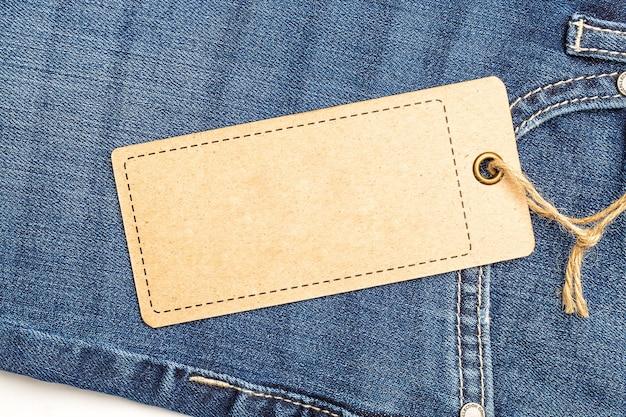 Label price tag mockup on blue jeans