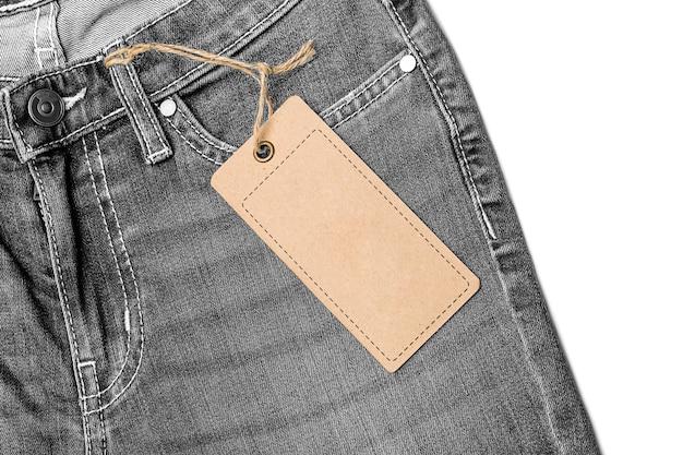 Label price tag mockup on grey jeans