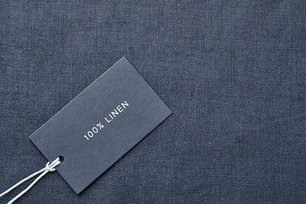 Ярлык с составом ткани на предпосылке ткани. 100% белье