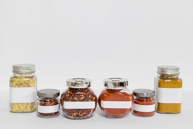 Labelled jars with different spices assortment
