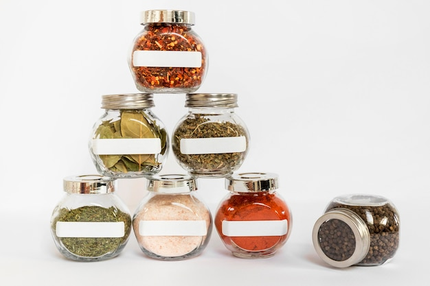 Labelled jars with spices assortment