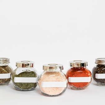Labelled jars with spices and copy-space