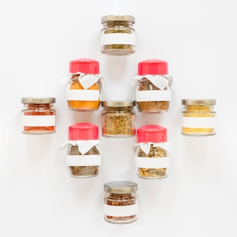 Labelled jars with spices above view