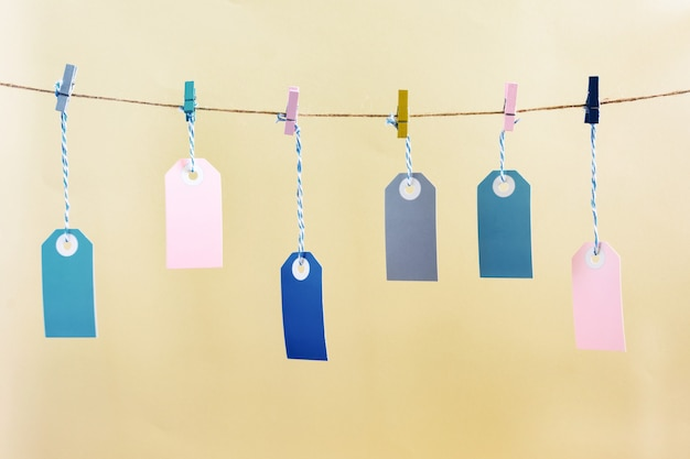 Labels hanging on a rope with colored clothespins