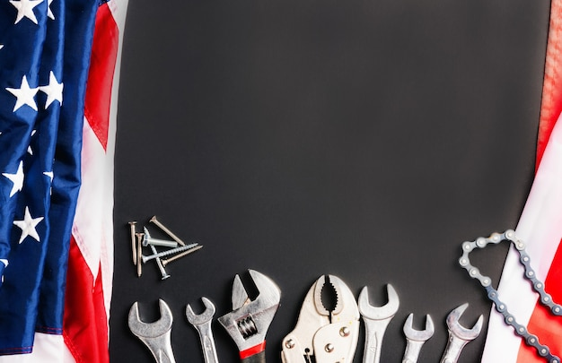 Labor day concept different kinds wrenches with american flag on black