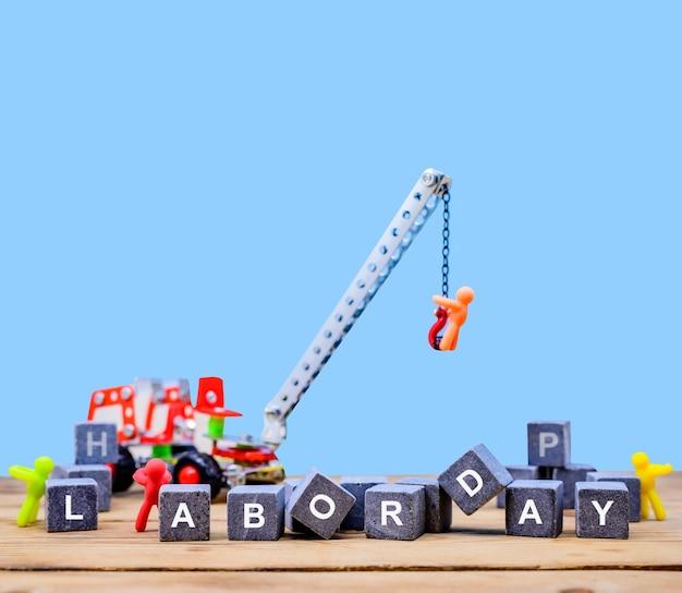 労働者の日の概念。建設のバックグラウンドを持つエンジニアと労働者。