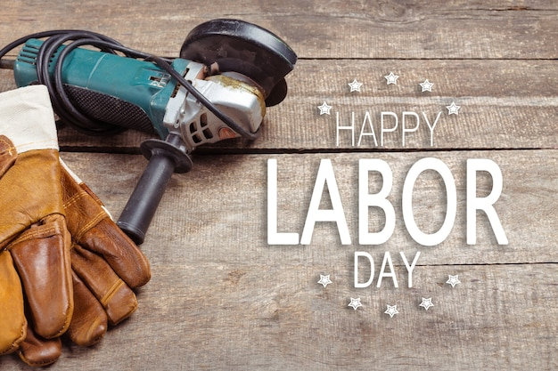 Labor day. different tools on wooden background .