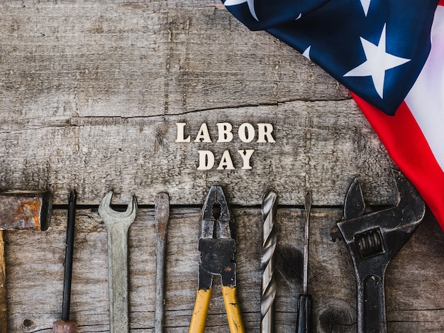 Labor day. hand tools and wooden letters